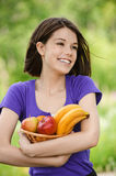 Young smiling woman holding basket Royalty Free Stock Photo