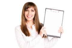 Young smiling woman holding blank paper sheet Royalty Free Stock Photo