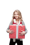 Young smiling woman holding christmas gift Royalty Free Stock Images