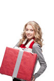 Young smiling woman holding christmas gift Stock Image