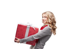 Young smiling woman holding christmas gift Stock Photography