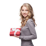 Young smiling woman holding christmas gift Royalty Free Stock Photography