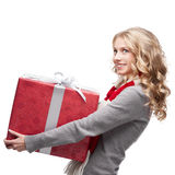 Young smiling woman holding christmas gift Stock Images