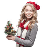 Young smiling woman holding christmas tree Royalty Free Stock Photos