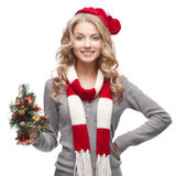 Young smiling woman holding christmas tree Stock Photo
