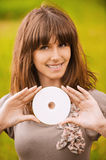 Young smiling woman holding compact Stock Photo