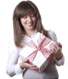 Young smiling woman holding gift Royalty Free Stock Photos
