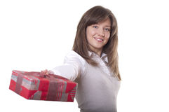 Young smiling woman holding gift Royalty Free Stock Image