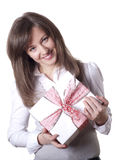 Young smiling woman holding gift Royalty Free Stock Photography