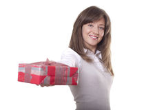 Young smiling woman holding gift Royalty Free Stock Images