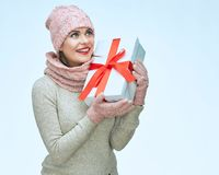 Young smiling woman holding gift box. Isolated studio portrait Stock Photos