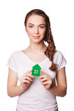 Young smiling woman holding green house. isolated on white Royalty Free Stock Photo