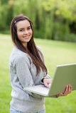 Young smiling woman holding her laptop Royalty Free Stock Image