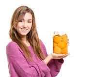 Young smiling woman holding home produce in a jar Stock Photos