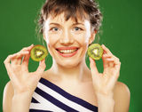 Young smiling woman holding kiwi. Stock Image