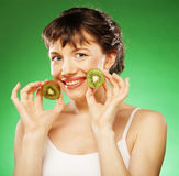 Young smiling woman holding kiwi. Royalty Free Stock Photo