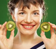 Young smiling woman holding kiwi. Royalty Free Stock Image