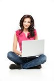 Young smiling woman holding laptop Stock Photo