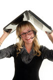 Young smiling woman holding laptop over her head Stock Photo
