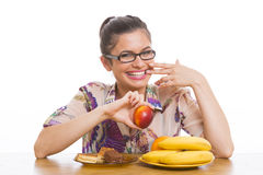 Young smiling woman holding nectarine Stock Images