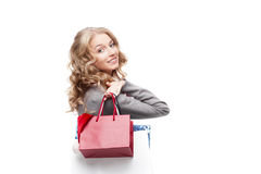 Young smiling woman holding shopping bags Stock Image
