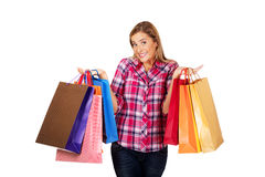 Young smiling woman holding shopping bags Stock Photos