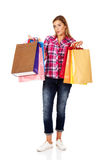 Young smiling woman holding shopping bags Royalty Free Stock Image