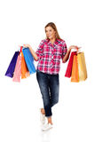 Young smiling woman holding shopping bags Stock Images