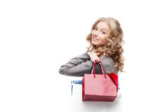 Young smiling woman holding shopping bags Stock Photography