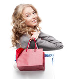 Young smiling woman holding shopping bags Royalty Free Stock Photo