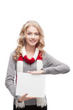 Young smiling woman holding sign Royalty Free Stock Photography
