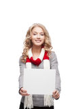 Young smiling woman holding sign Stock Photos