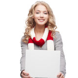 Young smiling woman holding sign Royalty Free Stock Image