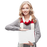 Young smiling woman holding sign Stock Photo