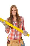 Young smiling woman holding spirit level royalty free stock photos