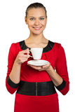 Young smiling woman holding tea cup Royalty Free Stock Images