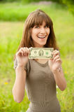 Young smiling woman holding two Stock Photo