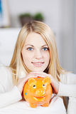 Young Smiling Woman Holding Yellow Piggy Bank Royalty Free Stock Photo