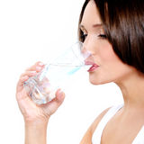 Young smiling woman holds glass of water Stock Photo