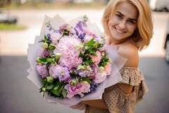 Free Young Smiling Woman Holds Tender Bouquet Of Flowers Royalty Free Stock Image - 188558796