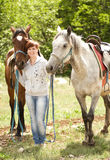 Young smiling woman with horse Royalty Free Stock Photo