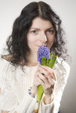 young smiling woman with hyacinth Stock Images