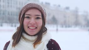A young smiling woman ice skating outside and skate closer to the camera. Portrait stock video footage