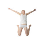 Young smiling woman jumping Royalty Free Stock Photos