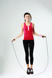 Young smiling woman jumping rope Stock Image