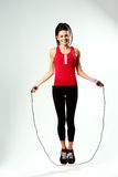 Young smiling woman jumping rope Royalty Free Stock Photography