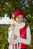 Young smiling woman keep herself warm Royalty Free Stock Image