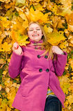 Young smiling woman on the leaves Stock Images