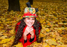 Young smiling woman on the leaves Royalty Free Stock Photos