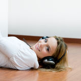 Young smiling woman listening music Royalty Free Stock Photos